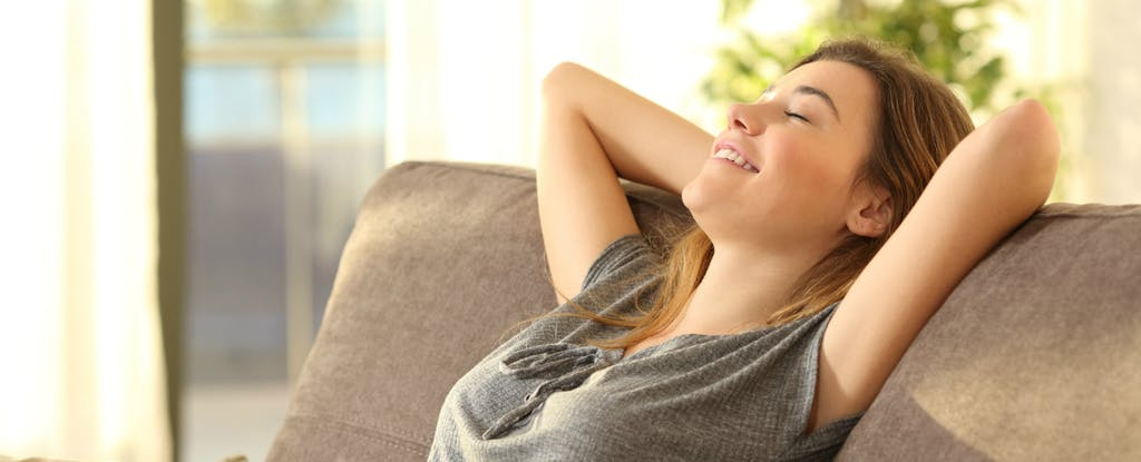 Woman relaxing because she can monitor her credit with Credit Karma