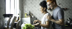 A couple cooking together in the kitchen