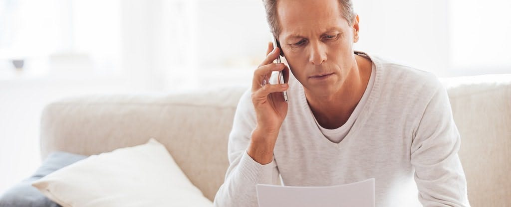 Man on the phone trying to cancel his credit card