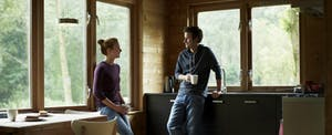 Couple having coffee in cottage.